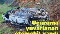 Uçuruma yuvarlanan otomobil yandı