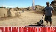 Heykellere Doberman koruması